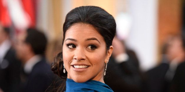 Gina Rodriguez arrives at the Oscars on Sunday, Feb. 22, 2015, at the Dolby Theatre in Los Angeles. (Photo by Chris Pizzello/