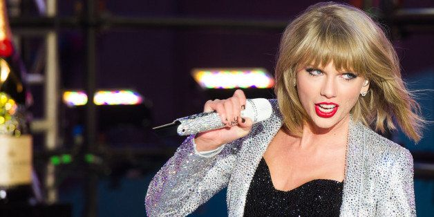 Taylor Swift performs in Times Square during New Year's Eve celebrations on Wednesday, Dec. 31, 2014 in New York. (Photo by C