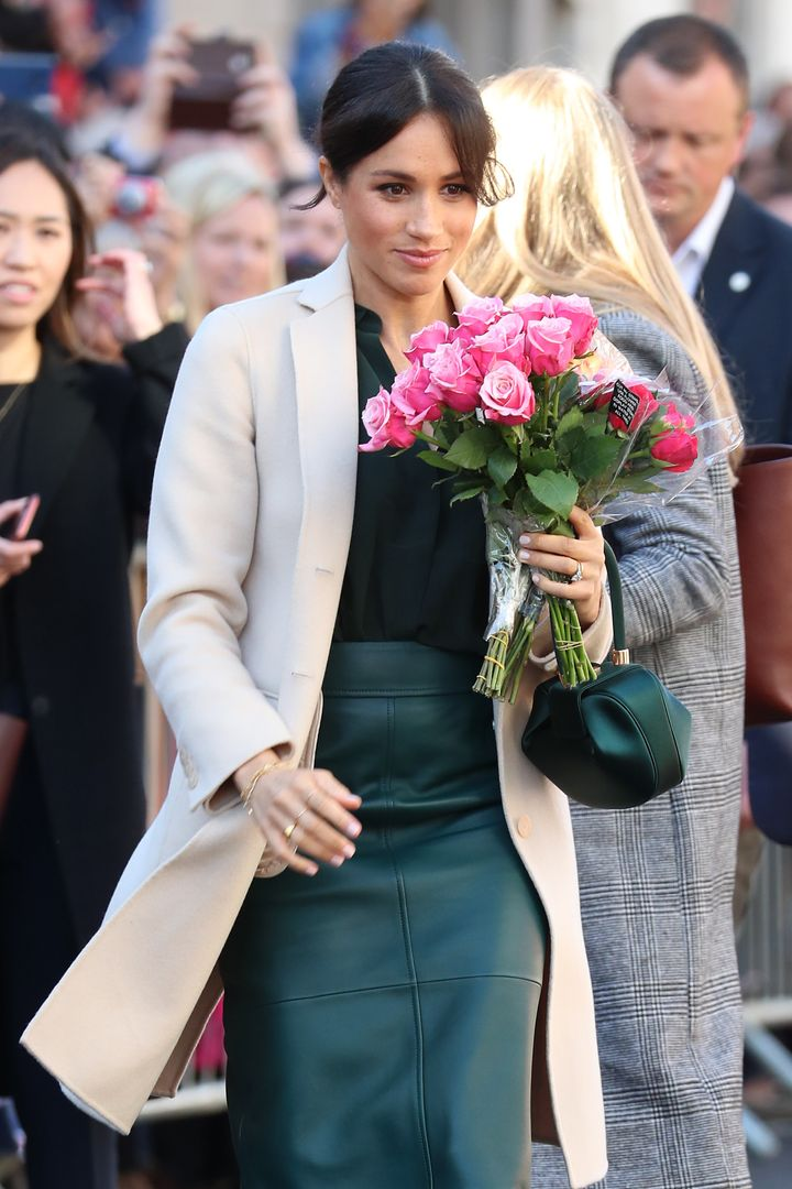 Holding flowers from a royal fan.