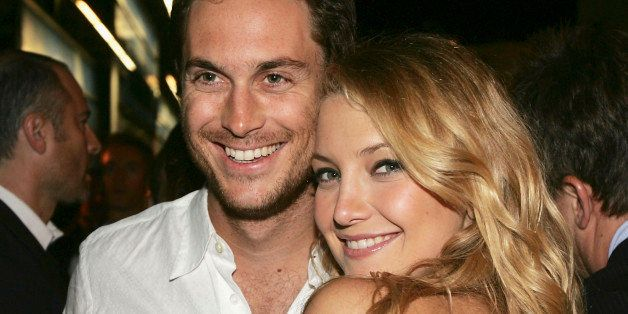 LOS ANGELES - AUGUST 2:  Actors Oliver Hudson and his sister Kate Hudson pose at the afterparty for the premiere of Universal