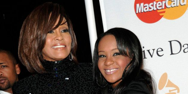 FILE - In this Feb. 12, 2011 file photo, singer Whitney Houston, left, and her daughter Bobbi Kristina arrive at the Pre-Gram