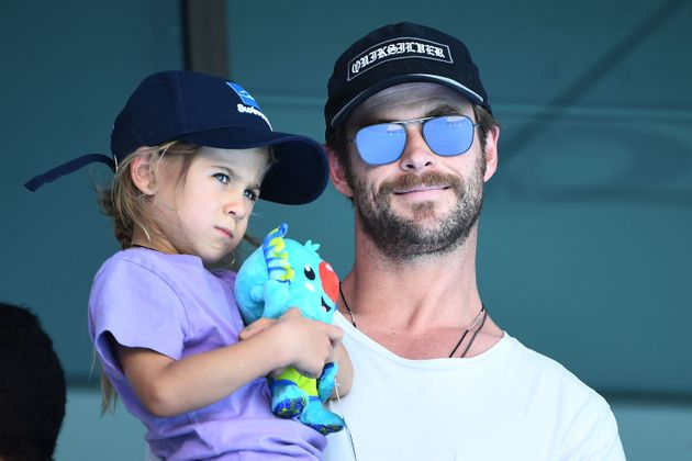 Actor Chris Hemsworth, holding daughter India Rose Hemsworth on the Gold Coast, Australia, in April,...