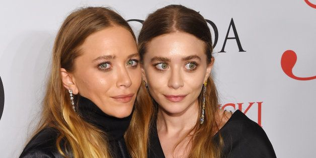 NEW YORK, NY - JUNE 01:  Mary-Kate Olsen and Ashley Olsen pose on the winners walk at the 2015 CFDA Fashion Awards at Alice T