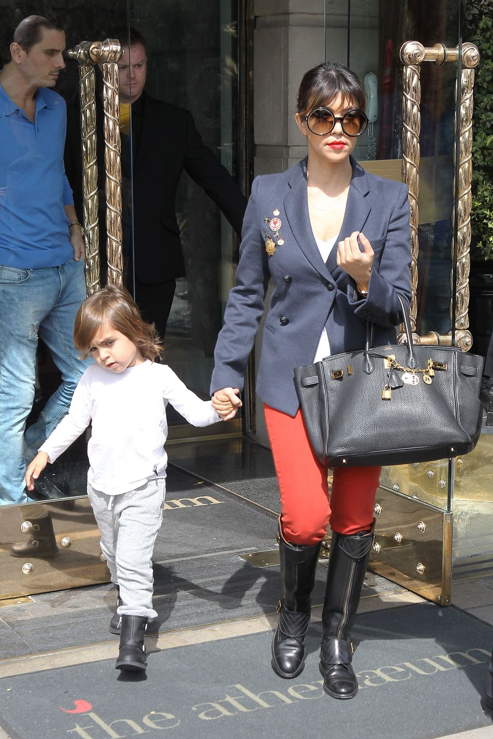 Kourtney Kardashian and her son Mason seen leaving their hotel on April 24, 2013 in London, England.