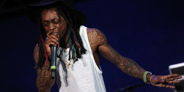 Singer Lil Wayne performs during a free concert in Champ de Mars, downtown Port-au-Prince on June 26, 2015. AFP PHOTO/HECTOR