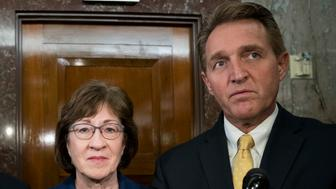 WASHINGTON, DC - JANUARY 22 : (L to R) Sen. Lindsey Graham (R-SC), Sen. Susan Collins (R-ME) and Sen. Jeff Flake (R-AZ) talk to reporters after a meeting with a bipartisan group of moderate Senators in Collins' office on Capitol Hill, January 22, 2018 in Washington, DC. Lawmakers are continuing to seek a deal to end the government shutdown, now in day three. (Photo by Drew Angerer/Getty Images)