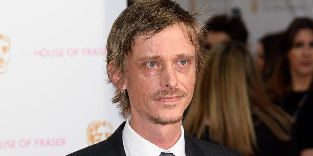 Mackenzie Crook poses for photographers upon arrival at the BAFTA Television awards in central London, Sunday, May 10, 2015.