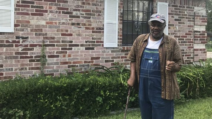 Johnnie Armstrong, 80, stands outside his home in Joppa, a historically black neighborhood in South Dallas. He bought his hou