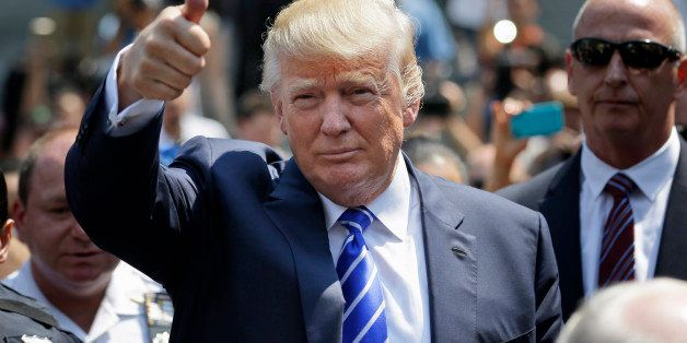 Donald Trump gives a thumbs-up as he leaves for lunch after being summoned for jury duty in New York, Monday, Aug. 17, 2015.