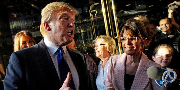 Donald Trump makes a point as he walks with former governor of Alaska Sarah Palin in New York City as they make their way to