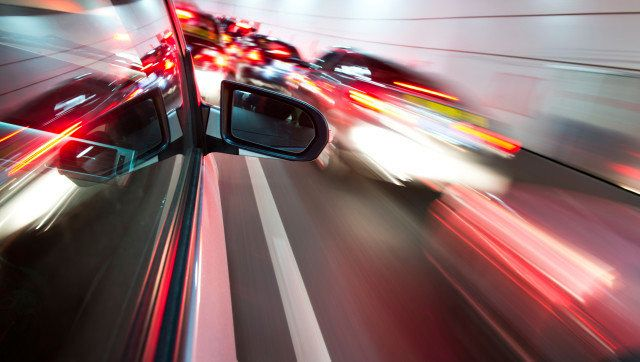 Fast car in night motion blur.