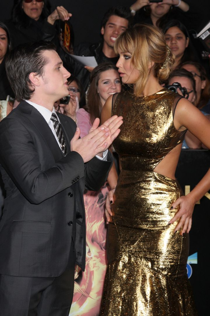 """LOS ANGELES - MAR 12:  Josh Hutcherson; Jennifer Lawrence arrives at the """"Hunger Games"""" Premiere at the Nokia Theater at LA L"""