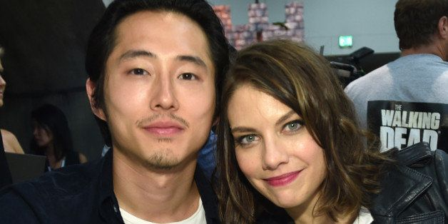 """Steven Yeun, left, and Lauren Cohan attend AMC's """"The Walking Dead"""" autograph signing on Day 2 of Comic-Con International on"""