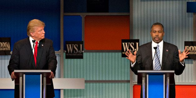 2016 Republican presidential candidates Donald Trump, president and chief executive of Trump Organization Inc., left, and Ben Carson, a retired neurosurgeon, participate in a presidential candidate debate in Milwaukee, Wisconsin, U.S., on Tuesday, Nov. 10, 2015. The fourth Republican debate, hosted by Fox Business Network and the Wall Street Journal, focuses on the economy with eight presidential candidates included in the main event and four in the undercard version. Photographer: Daniel Acker/Bloomberg via Getty Images