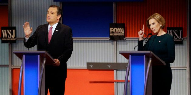 Ted Cruz speaks as Carly Fiorina tries to make a comment during a Republican presidential debate at the Milwaukee Theatre, Tu