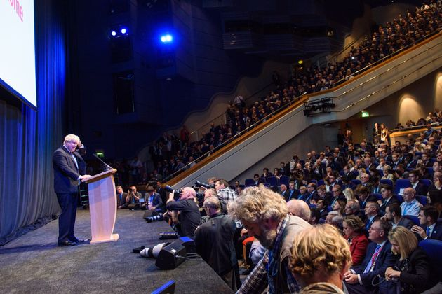 Boris Johnson addresses over 1,000 fans at the Tory conference as he trashes the PM's Brexit
