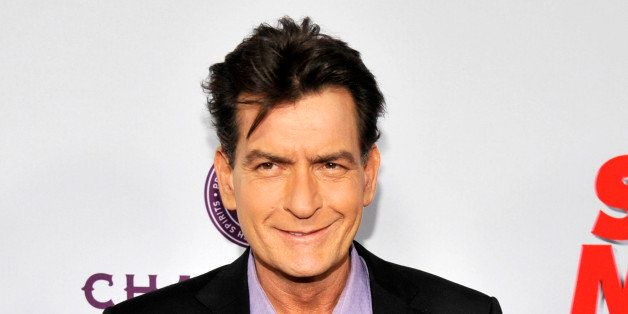 """FILE - In this April 11, 2013 file photo, Charlie Sheen, a cast member in """"Scary Movie V,"""" poses at the Los Angeles premiere"""