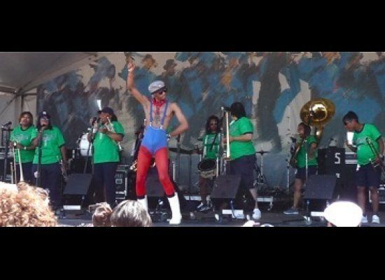 The Original Pinettes Brass Band with Jack Spratt as Hamp the High Stepper.