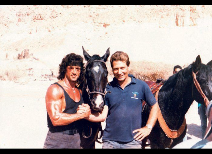 """Armstrong with Stallone on the set of """"Rambo III."""" That horse between them is the same horse Armstrong used in """"The Last Crus"""