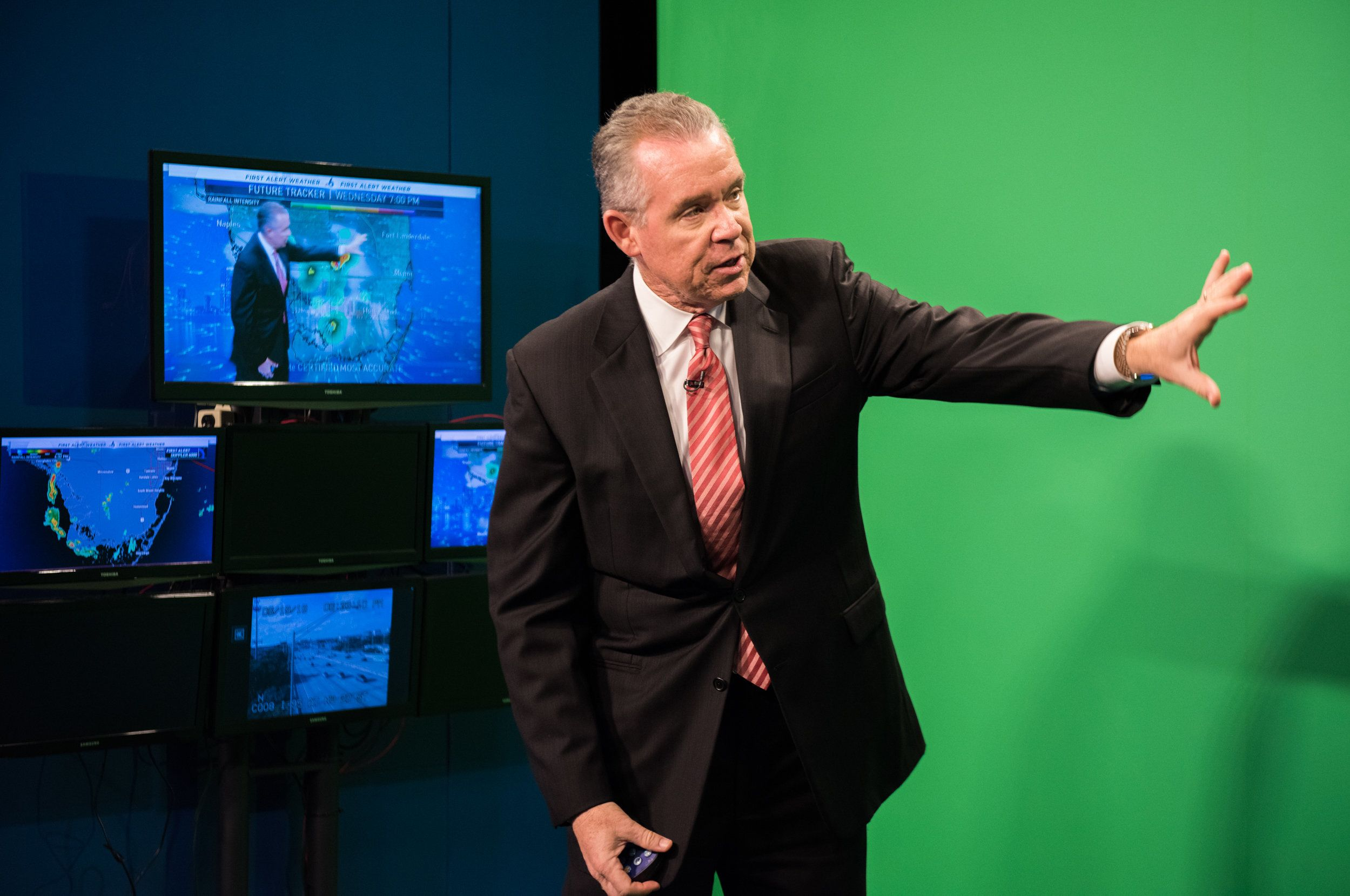 Morales in front of the green screen at NBC-6 during one of his weather segments.