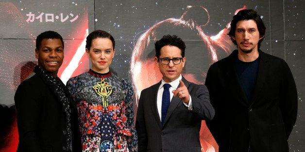 Director J.J. Abrams, second from right, and actors John Boyega, left, Daisy Ridley, second left, and Adam Driver pose for th