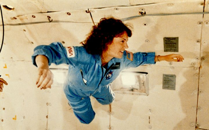 "Christa McAuliffe suspends in the air during a training exercise on a ""zero gravity"" aircraft."