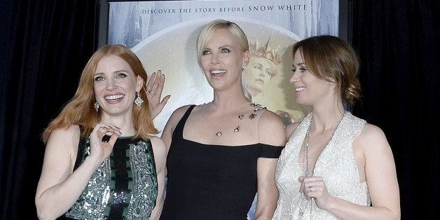 """Cast members Jessica Chastain (L), Charlize Theron (C) and Emily Blunt pose during the premiere of the film """"The Huntsman: Wi"""