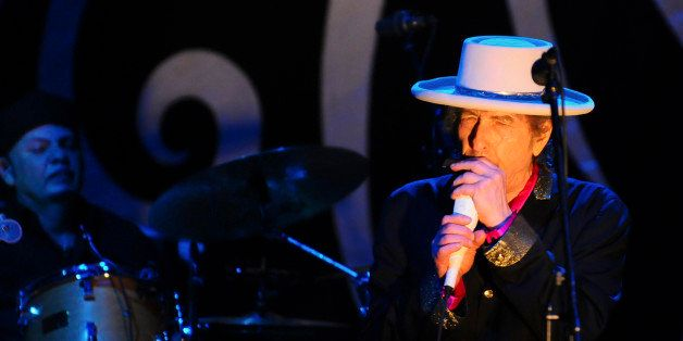 Singer Bob Dylan (R) performs during his show in Vietnam's southern Ho Chi Minh city April 10, 2011. Dylan is in Vietnam for