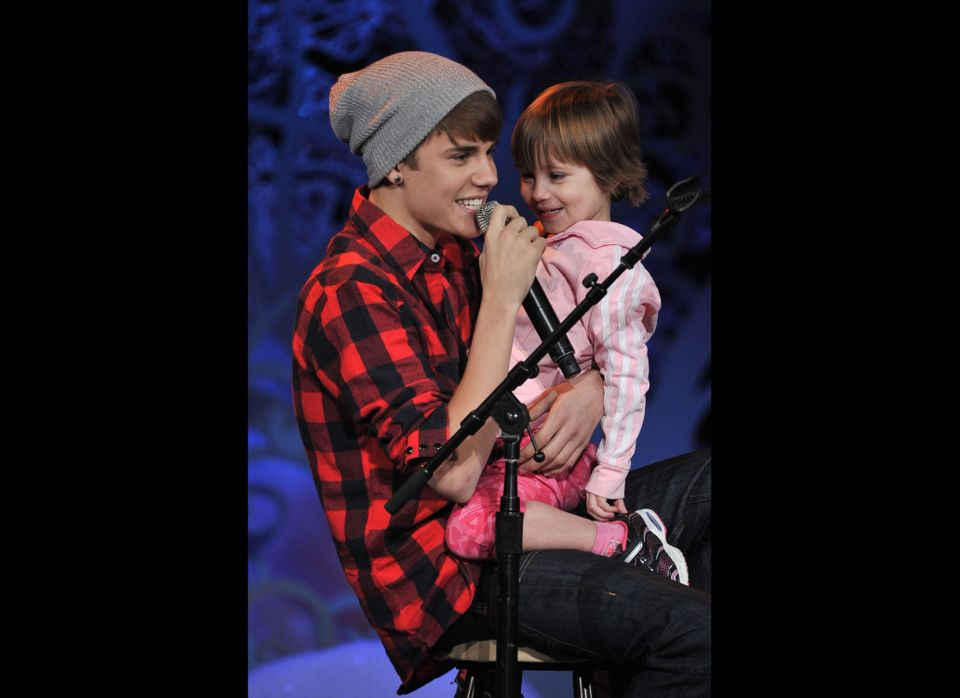 Justin Bieber sings with three-year-old sister, Jazmyn, at his holiday concert special at Massey Hall in Toronto, Canada.