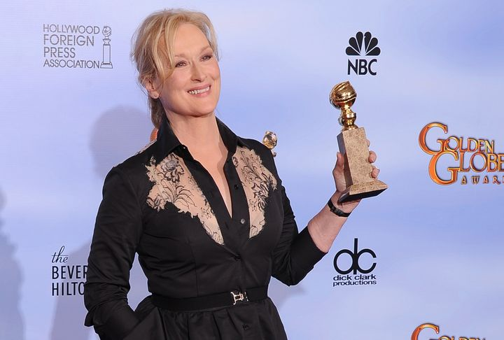 The winner for Best Performance by an Actress in a Motion Picture Drama Meryl Streep poses with the trophy at the 69th annual Golden Globe Awards at the Beverly Hilton Hotel in Beverly Hills, California, January 15, 2012. AFP PHOTO / Robyn BECK (Photo credit should read ROBYN BECK/AFP/Getty Images)