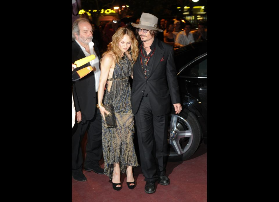 French actress Vanessa Paradis (L) and her husband, US actor Johnny Depp (R) arrive to attend the Figaro Madame/Chanel dinner