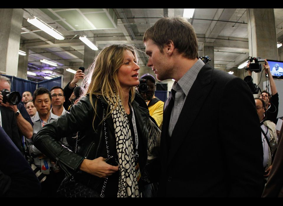 Tom Brady #12 of the New England Patriots chats with his wife Gisele Bundchen after losing to the New York Giants by a score