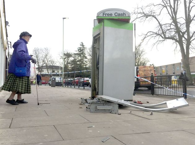 A woman walks past the scene outside Heron Foods on Cockerton Green, Darlington, after thieves blew up a cash machine