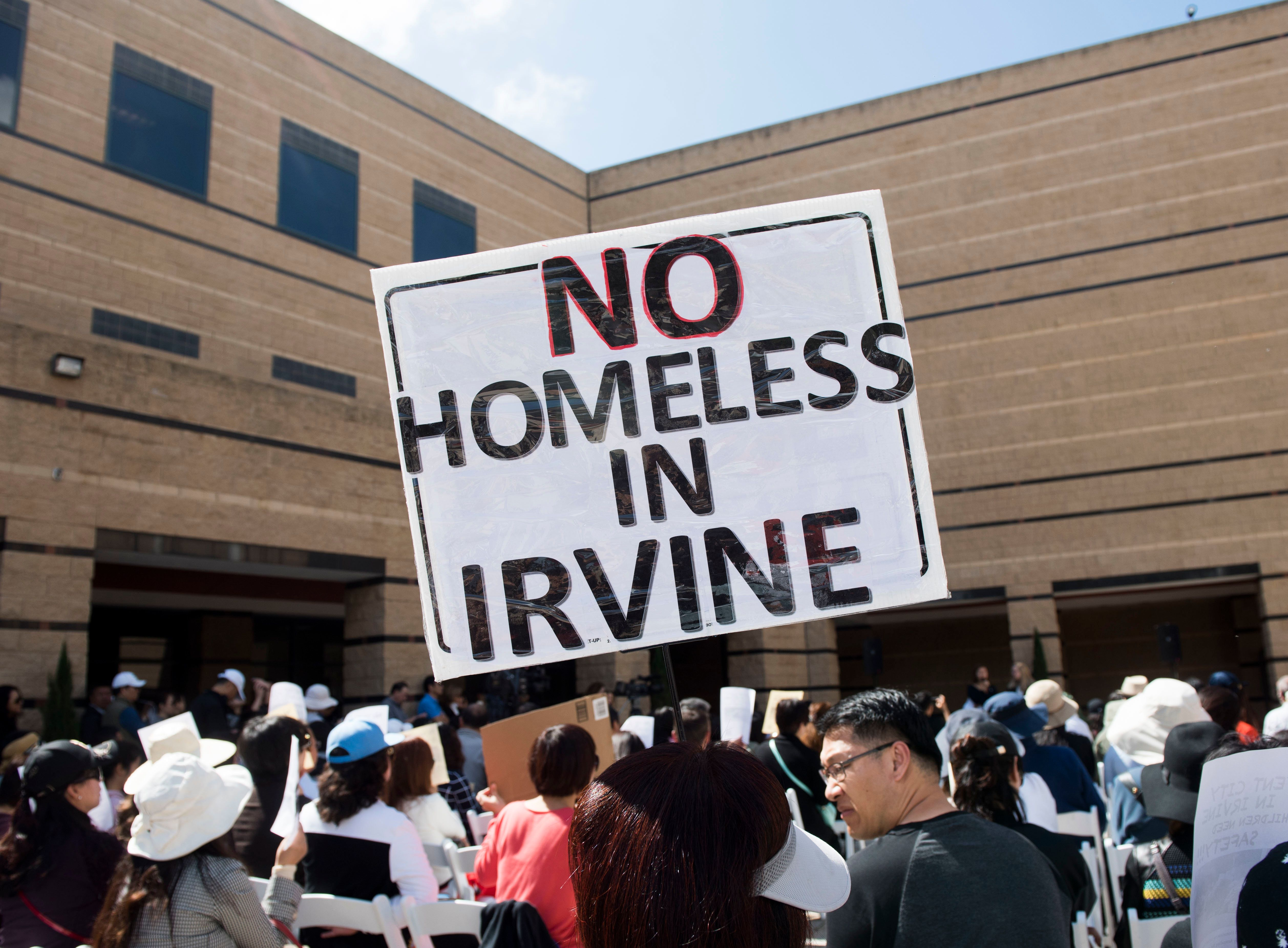 Irvine residents protested in March in response to the county's plan to build a homeless shelter in the city. The county later reversed the decision.