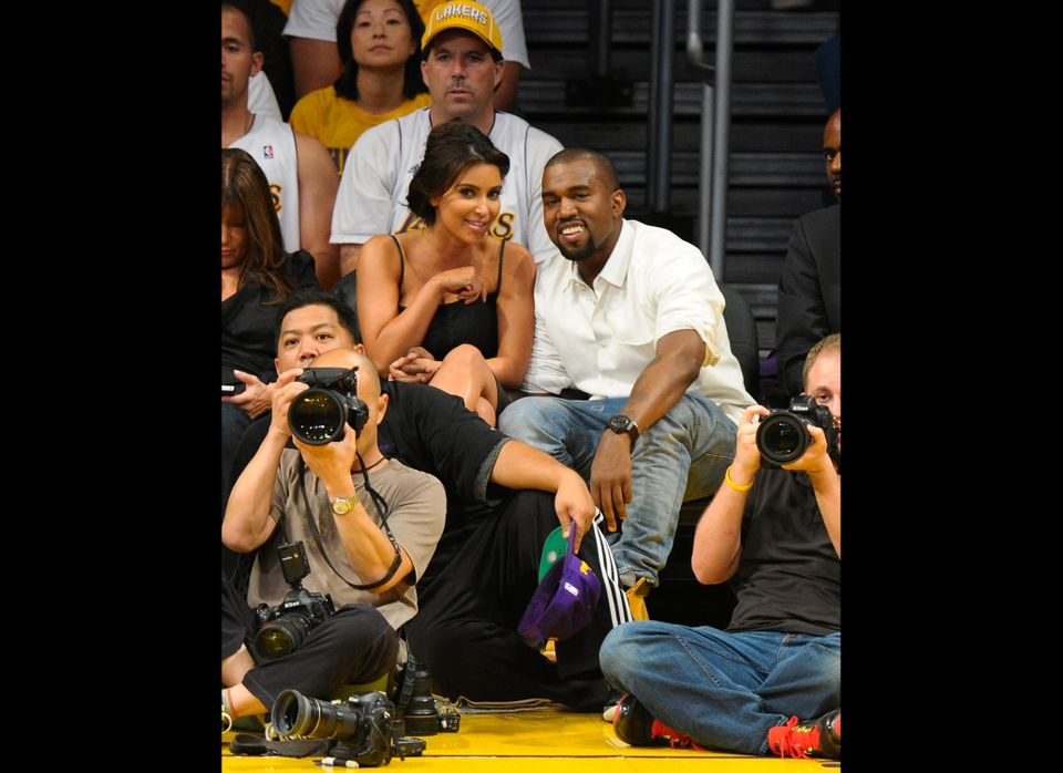 LOS ANGELES, CA - MAY 12:  Kim Kardashian (L) and Kanye West attend the Los Angeles Lakers and Denver Nuggets Game 7 of the W