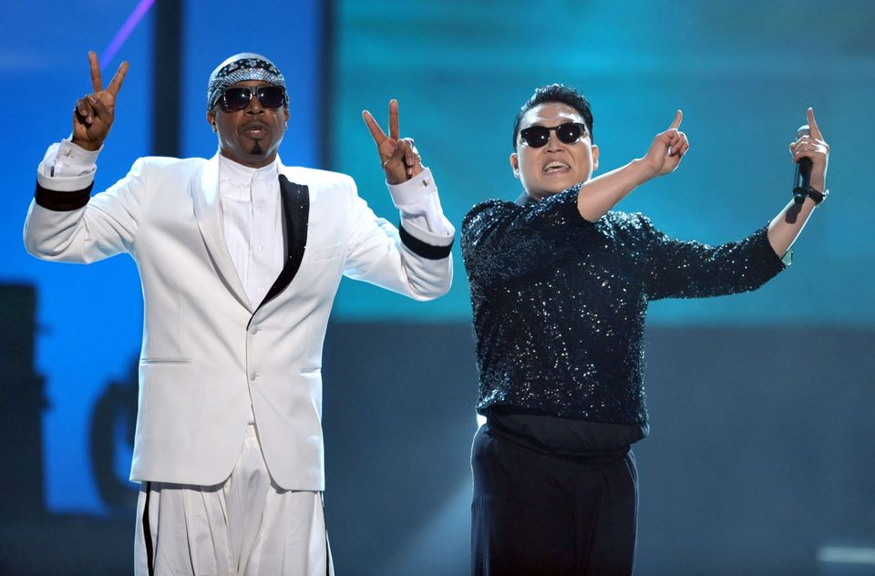 MC Hammer, left, and PSY appear on stage at the 40th Anniversary American Music Awards on Sunday, Nov. 18, 2012, in Los Angel
