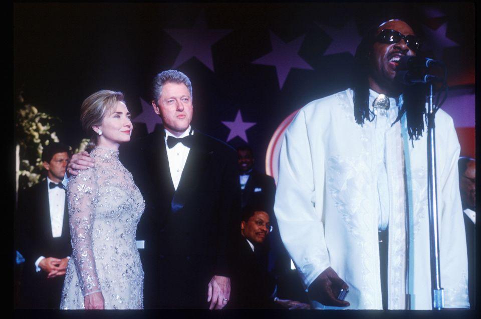 291964 02: (NO NEWSWEEK - NO USNEWS) President Bill Clinton and his wife Hillary watch singer Stevie Wonder at an inaugural b