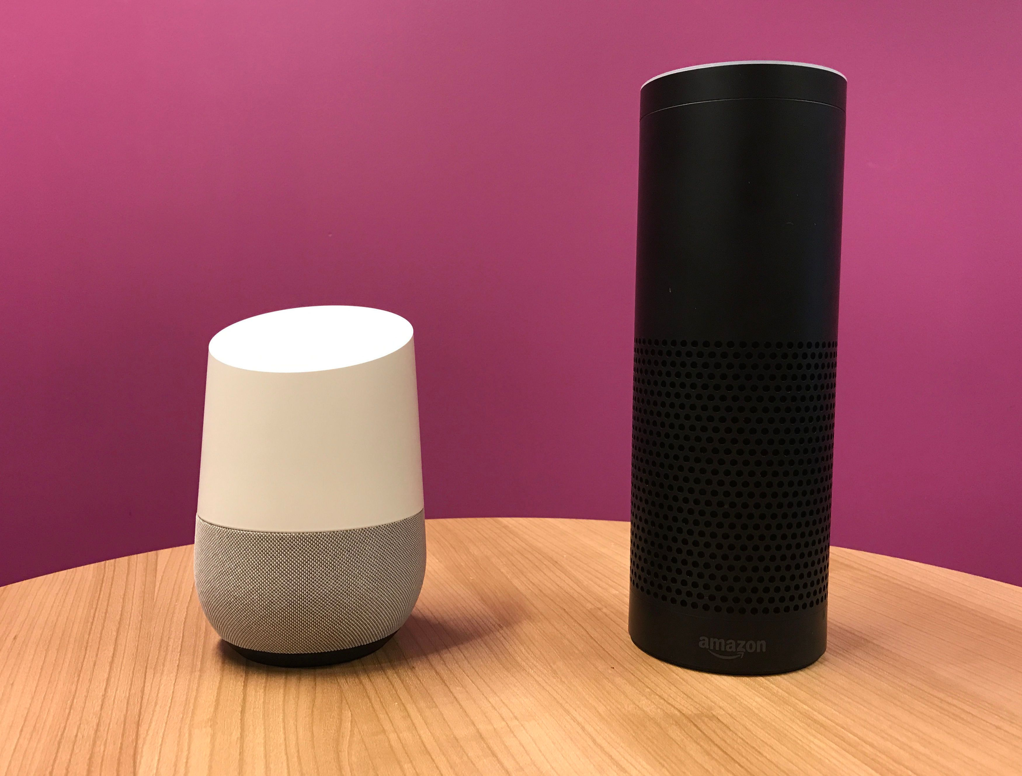 Google Home (left) which has been launched in the UK to rival Amazon's Echo (right), in London.