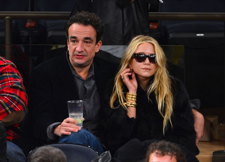 NEW YORK, NY - DECEMBER 15:  Olivier Sarkozy and Mary-Kate Olsen attend the Cleveland Cavaliers vs New York Knicks game at Ma