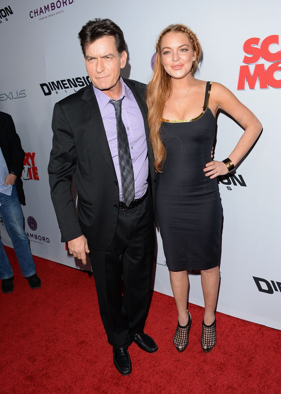 HOLLYWOOD, CA - APRIL 11:  Actors Charlie Sheen (L) and Lindsay Lohan arrive at the Dimension Films' 'Scary Movie 5' premiere