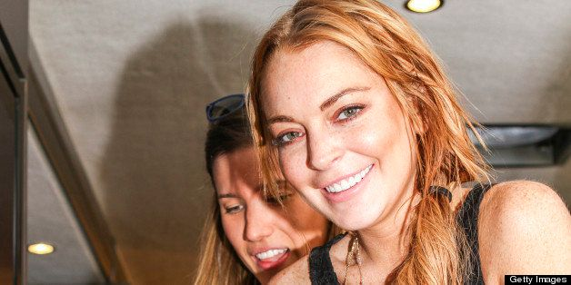 UNSPECIFIED LOCATION - APRIL 14:  In this handout photo provided by Kari Feinstein PR, Lindsay Lohan holding Elecrtic Picks,