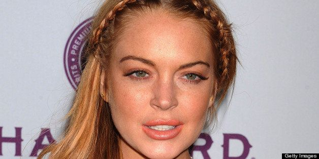 fd52bd0c HOLLYWOOD, CA - APRIL 11: Actress Lindsay Lohan arrives at the 'Scary Movie