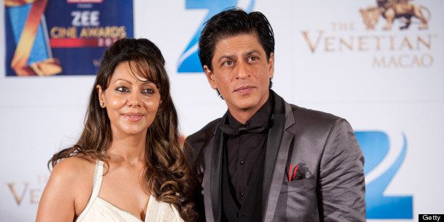 MACAU, CHINA - JANUARY 21:  Indian actor Shah Rukh Khan and his wife Gauri Khan attends red carpet during the Zee Cine Awards
