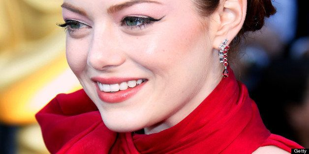 HOLLYWOOD, CA - FEBRUARY 26: Actor Emma Stone arrives at the 84th Annual Academy Awards held at Hollywood & Highland Centre o
