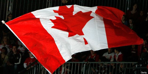 VANCOUVER, BC - MARCH 19:  A Canadian flag is waves in the air in support of Team Canada during the Ice Sledge Hockey Bronze