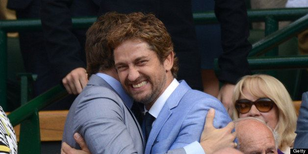 LONDON, ENGLAND - JULY 07:  Bradley Cooper and Gerard Butler attend the Men's Singles Final between Novak Djokovic and Andy M