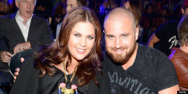 NASHVILLE, TN - JUNE 05:  Singer Hillary Scott of the band Lady Antebellum and musician Chris Tyrrell attend the 2013 CMT Mus