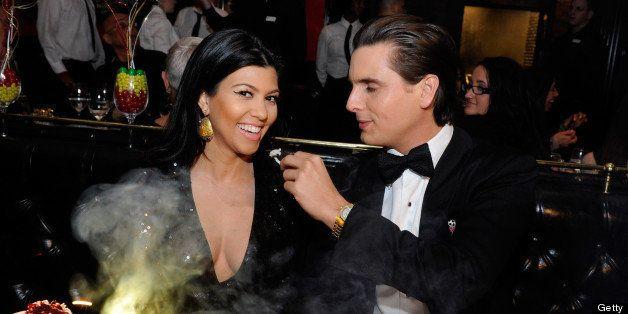 LAS VEGAS, NV - DECEMBER 31:  (EXCLUSIVE COVERAGE)  Television personalities Kourtney Kardashian (L) and Scott Disick celebra
