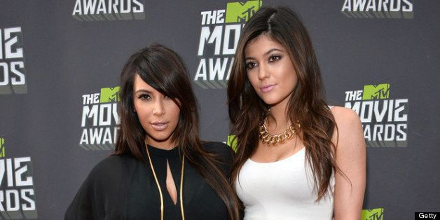 CULVER CITY, CA - APRIL 14:  TV personalities Kim Kardashian (L) and Kylie Jenner arrive at the 2013 MTV Movie Awards at Sony