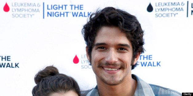 UNIVERSAL CITY, CA - JULY 27:  Actor Tyler Posey (R) and guest attend Variety's Power of Youth presented by Hasbro, Inc. and